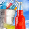 Close-up view of bottles with ice — Stock Photo