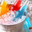 Bottles of cooler drinks with ice — Stock Photo