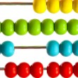 Closeup of bright  abacus beads on white - Stock Photo