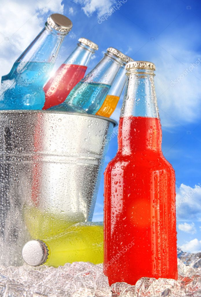 Close-up view of bottles with ice against blue sky  Stock Photo #6130348