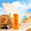 Sunblock lotion and beach items on table — Stock Photo