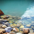 Closeup of rocks in water at lake Louise — Stock fotografie