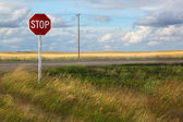 Rural stop sign on the prairies — Stock Photo