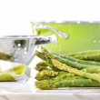 Green asparagus on marble table — Stock Photo