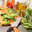 Preparing sinach leaves on cutting board - Stock Photo