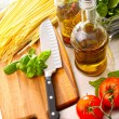 Preparation for making fettuccine with sauce and basil - Stock Photo
