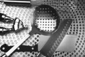 Kitchen utensils on stainless steel — Stock Photo