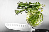 Rosemary leaves with cutting on stainless steel — Stock Photo