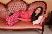 Girl in pyjama in sofa. — Stock Photo