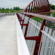 Futuristic pedestrian bridge. — Stock Photo