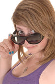 Girl looking over sunglasses. — Stock Photo