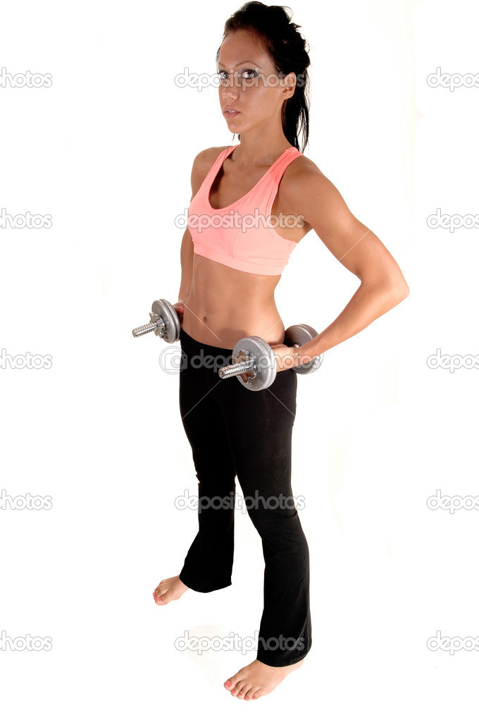 A pretty woman with dumbbells lifting, standing in the studio with barefeet, for white background. — Stock Photo #6434621