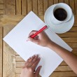 Royalty-Free Stock Photo: Pencil writing on a white sheet of paper