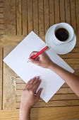 Pencil writing on a white sheet of paper — Stock Photo