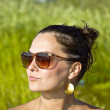 Girl in sunglasses on the beach — Stock Photo