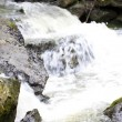 Water running in a mountain creek - Stock Photo
