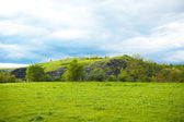 Hill on a background of green field — Foto Stock