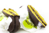 Pieces of cake with cream and kiwi — Stock Photo