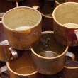 Stock Photo: Background earthenware mugs