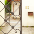 Appearance of the house through wrought fence — Stock Photo