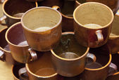 Background earthenware mugs — Stock Photo