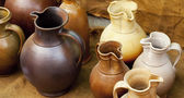 Earthenware jars standing on linen rag — Stock Photo