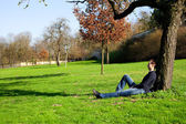 Man resting in a tree — Stock Photo