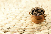 Coffee beans in a small jug — Stock Photo