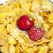 Background of  bowl of cornflakes milk  cherry  and strawberry — Stock Photo