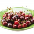 Stock Photo: Cherries in plate isolated on white