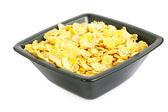 Bowl of cornflakes isolated on white — Stock Photo