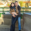 Young couple on the Charles Bridge on the skyline — Stock Photo #5991516
