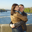 Young couple on the Charles Bridge on the skyline — Stock Photo