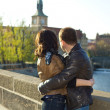 Stock Photo: Young couple on the Charles Bridge on the skyline