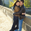 Young couple on the Charles Bridge on the skyline — Stock Photo #5991636