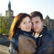 Young couple on the Charles Bridge on the skyline — Stock Photo #5991642