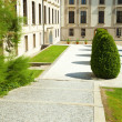 Square of the city with green bushes — Stock Photo