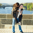 Young couple on the Charles Bridge — Stock Photo #5996294