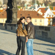 Young couple on the Charles Bridge — Stock Photo #5996309