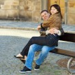 Love couple sitting on the bench — Stock Photo #5996425