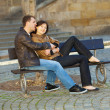 Love couple sitting on the bench — Stock Photo #5996430