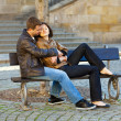 Love couple sitting on the bench — Stock Photo