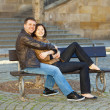 Love couple sitting on the bench — Stock Photo #5996452