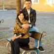 Love couple sitting on a bench — Stock Photo #5996541