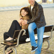 Love couple sitting on a bench — Stock Photo #5996570