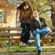 Love couple sitting on a bench — Stock Photo #5996786