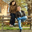 Love couple sitting on a bench — Stock Photo