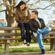 Love couple sitting on a bench — Stock Photo #5996806