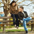 Stock Photo: Love couple sitting on a bench