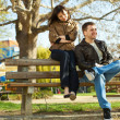 Love couple sitting on a bench — Stock Photo #5996817